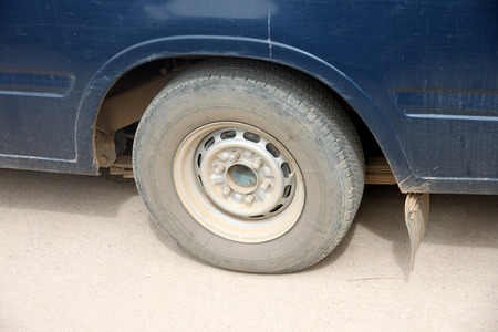 payload: Wheel of the pickup in payload is too heavy.  Stock Photo
