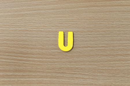 english language: alphabet of English language on wood background.