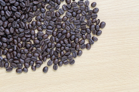 placed: Coffee beans placed on a wooden . Stock Photo