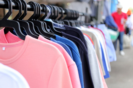 clothes hanging: Colorful clothes hanging on clothesline. Stock Photo