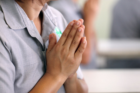 of homage: Hand is to pay homage on the philanthropy. Stock Photo