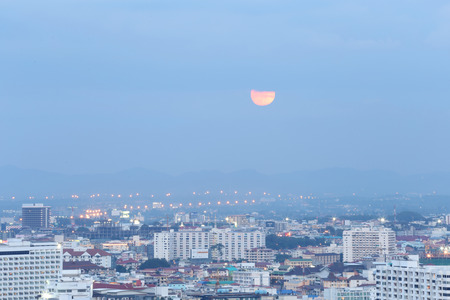 half moon: Landscape of Pattaya City  in time near darkness and the half moon. Stock Photo