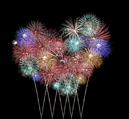 Mix Fireworks or firecracker in heart Shape on the darkness. photo