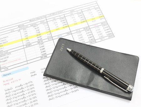 placed: Pen and black notebook placed on the document. Stock Photo