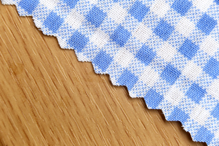 scots: blue fabric of scots pattern on wooden for the background. Stock Photo