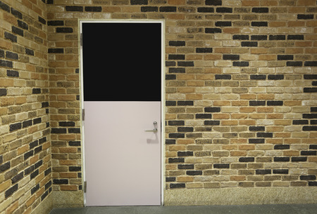 home interiors: Door and brick wall in home interiors.