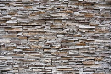 背景デザインの石壁。