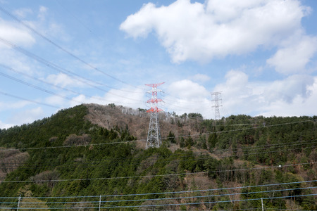 hilltop: High voltage electric pole on a hilltop in Japan. Stock Photo
