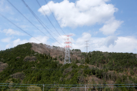 polarity: High voltage electric pole on a hilltop in Japan. Stock Photo