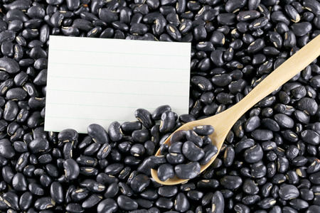 note paper: pile black beans and note paper for food background. Stock Photo