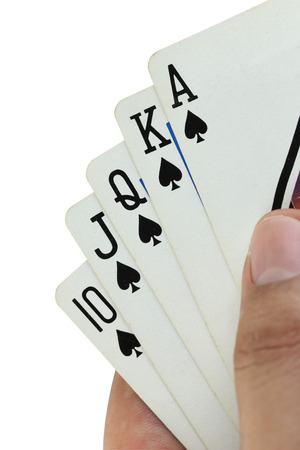 royal flush: royal flush playing cards in hand on white background. Stock Photo