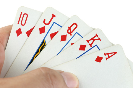 flush: royal flush playing cards in hand on white background. Stock Photo