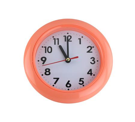 wall clock: orange wall clock isolated on white background. Stock Photo