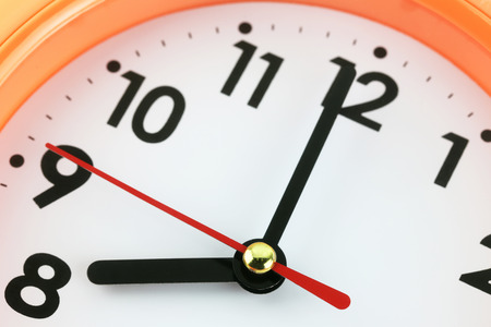 minute hand: Clock face in time concept,macro image. Stock Photo