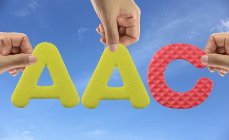to arrange: Hand arrange alphabet AAC of acronym Advanced Audio CODE. Stock Photo