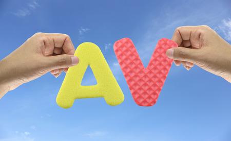 av: Hand arrange alphabet AV of acronym Adult Video very popular in Japan. Stock Photo