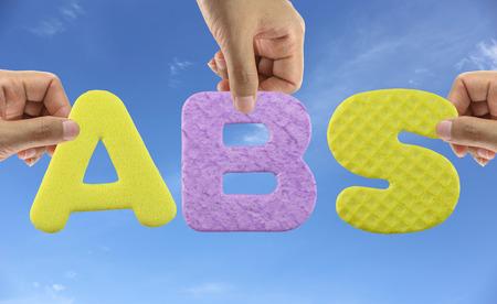 braking: Hand arrange alphabet ABS of acronym Antilock Braking System in car. Stock Photo