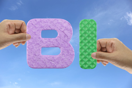 bi: Hand arrange alphabet BI of acronym Business intelligence in system organizations management.