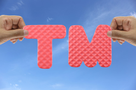 tm: Hand arrange alphabet TM of acronym Trade Mark for Business organizations management. Stock Photo