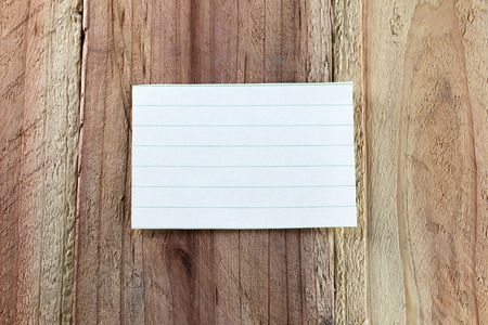 note paper: Note paper on wood background.