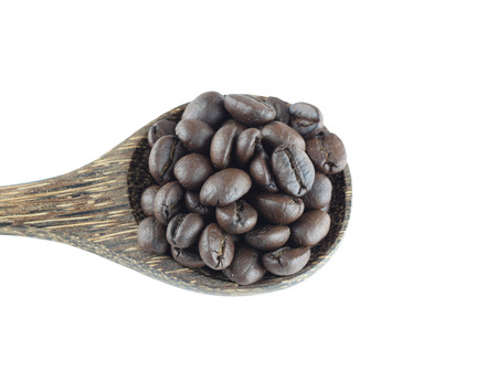 objects with clipping paths: Coffee beans in wooden spoon isolated on white background with clipping paths. Stock Photo