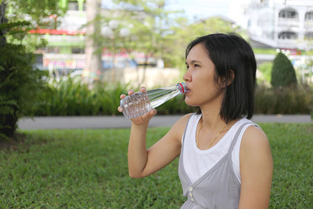 conceive: Thai pregnant mom was drinking water in the garden for good health.