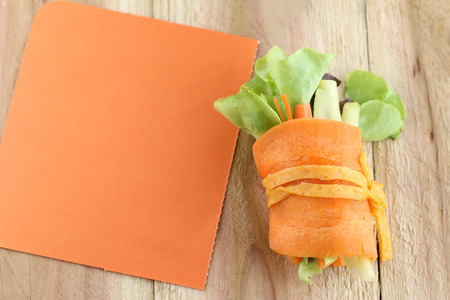 note paper: roll salad roll salad and note paper on wood background.