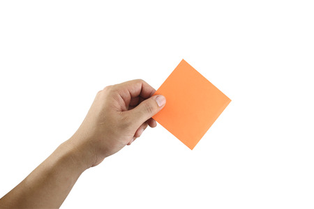 note paper: Mans arm showing orange note paper in hand and isolated on white background with clipping paths.