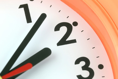 hands on face: Clock face in time concept,macro image. Stock Photo