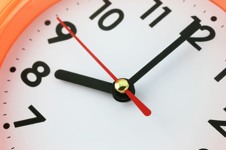clock hand: Clock face in time concept,macro image. Stock Photo