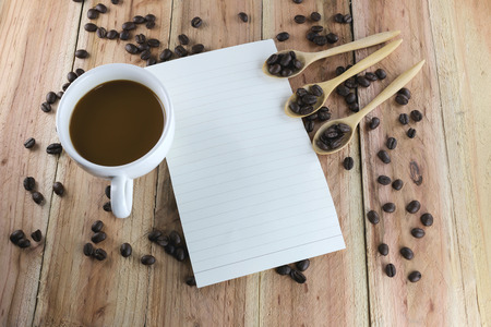 note paper: White coffee cup and note paper on wood background.