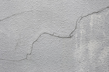 cracked cement: Cracked cement wall for the background.
