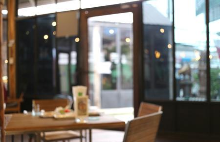 背景イメージのぼかしスタイルのコーヒー ショップ。 写真素材