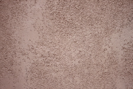 uneven: uneven surface of the brown cement wall for design background.