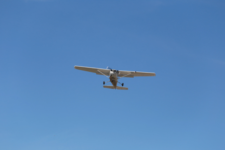 small plane: small plane on blue sky in bright day.