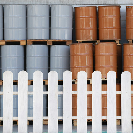 separates: White fence that separates the area of the storage tanks of hazardous chemicals.