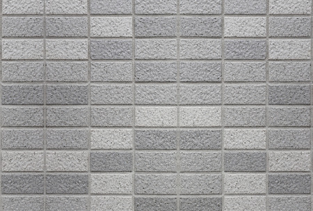 tile cladding: Stone granite pieces of tiles wall for the design background.