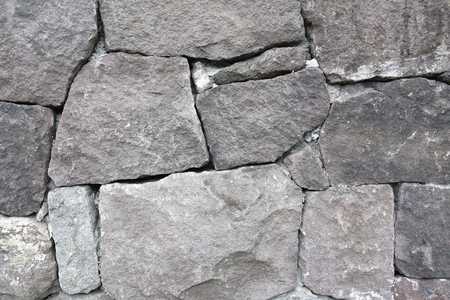 cladding tile: Stacked old stone wall for the design background. Stock Photo