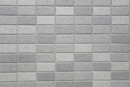 wall covering: Stone granite pieces of tiles wall for the design background.