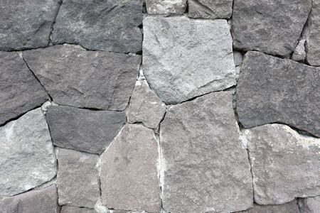 tile cladding: Stacked old stone wall for the design background. Stock Photo