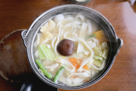 japanese cooking: Japanese noodle soup of Udon Ramen (in Japanese cooking) wheat pasta made in thick strips,original local Japan foods.