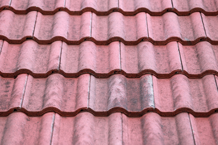 roof tiles: Weathered of old roof tiles for construction background.