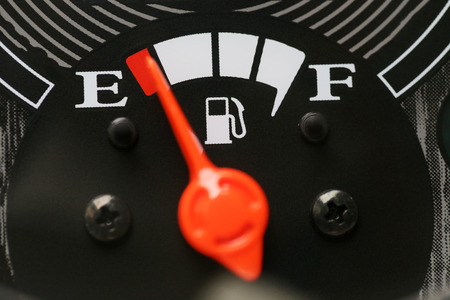fuel gauge: Fuel gauge with warning indicating low fuel tank,Gas gauge indicating white icon for gas station. Stock Photo