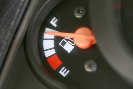 gas gauge: Fuel gauge with warning indicating quantity fuel tank,Gas gauge indicating white icon for gas station. Stock Photo