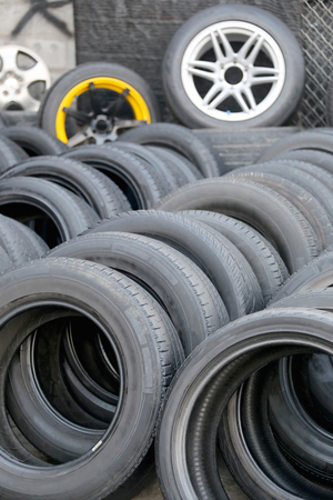 tyre tread: Pile of used rubber tyres in the garage shop. Stock Photo