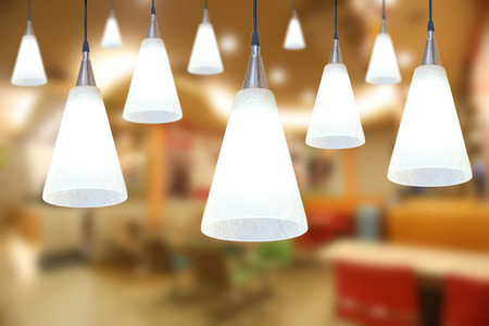 Warm lighting modern ceiling lamps in the cafe and interior decoration restaurant. 版權商用圖片