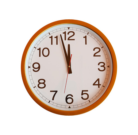 o'clock: orange wall clock isolated in twelve oclock on white background.