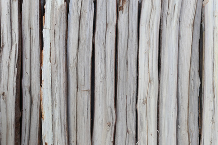 firewood in concatenation to wood background for design. Stock Photo