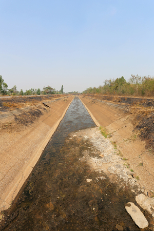 lack water: irrigation ditch no have a water because of drought weather,Summer in countryside Thailand. Stock Photo