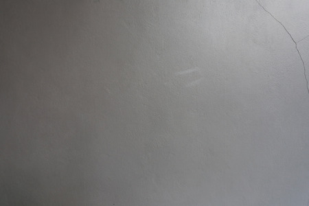 damaged cement: Gray cement wall of damaged with light and shadow for the background design.